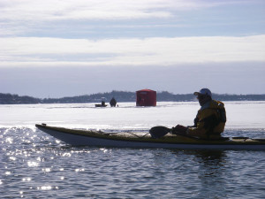 Only in Wisconsin: a kayaker enjoys a rare patch of open winter water, while 100 yards away, an ice fisherman waits for a bite. Now let's go bowling!